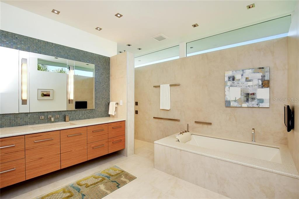 HER master suite bathroom includes pearl whirlpool tub, walk-in shower with body spray & rain Head, fog free mirror, extra deep teak cabinetry, and Dornbracht fixtures. - Single Family Home for sale at 593 Rountree Dr, Longboat Key, FL 34228 - MLS Number is A4172941