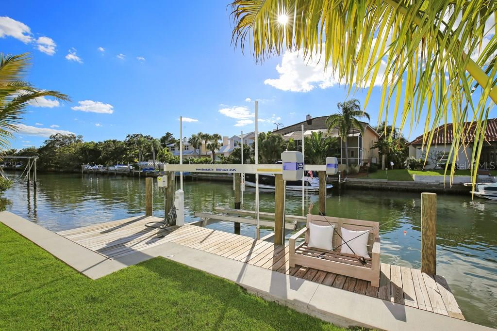 New seawall, cap, dock and 13,000lb boat lift completed in 2016. - Single Family Home for sale at 4934 Commonwealth Dr, Sarasota, FL 34242 - MLS Number is A4175945
