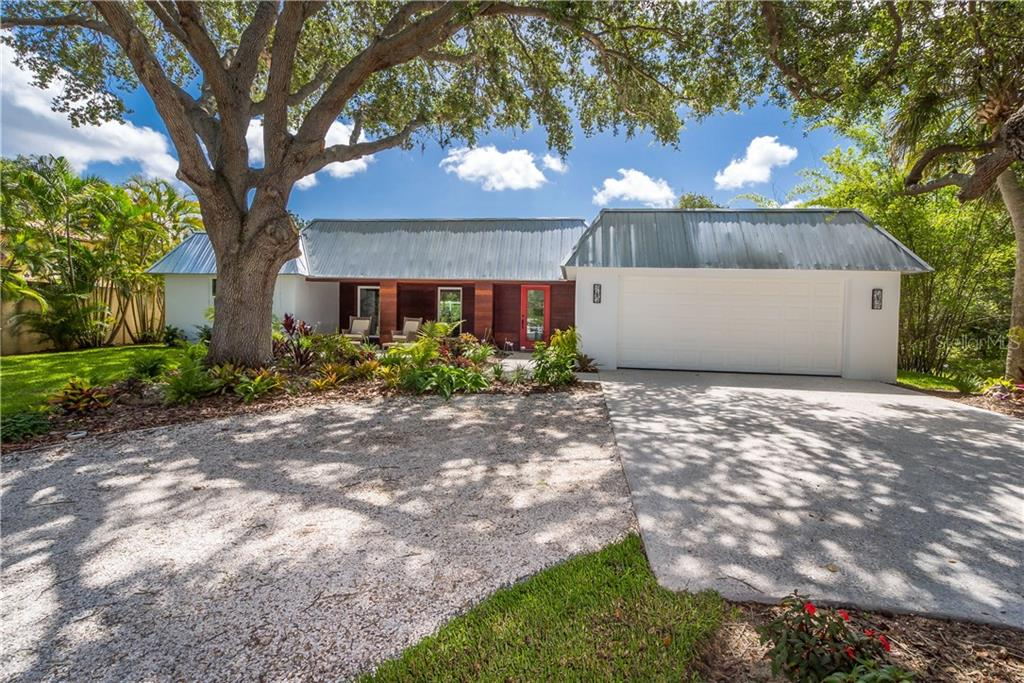 Situated on a large lot with mature landscaping. - Single Family Home for sale at 5115 Dewey Pl, Sarasota, FL 34242 - MLS Number is A4177178