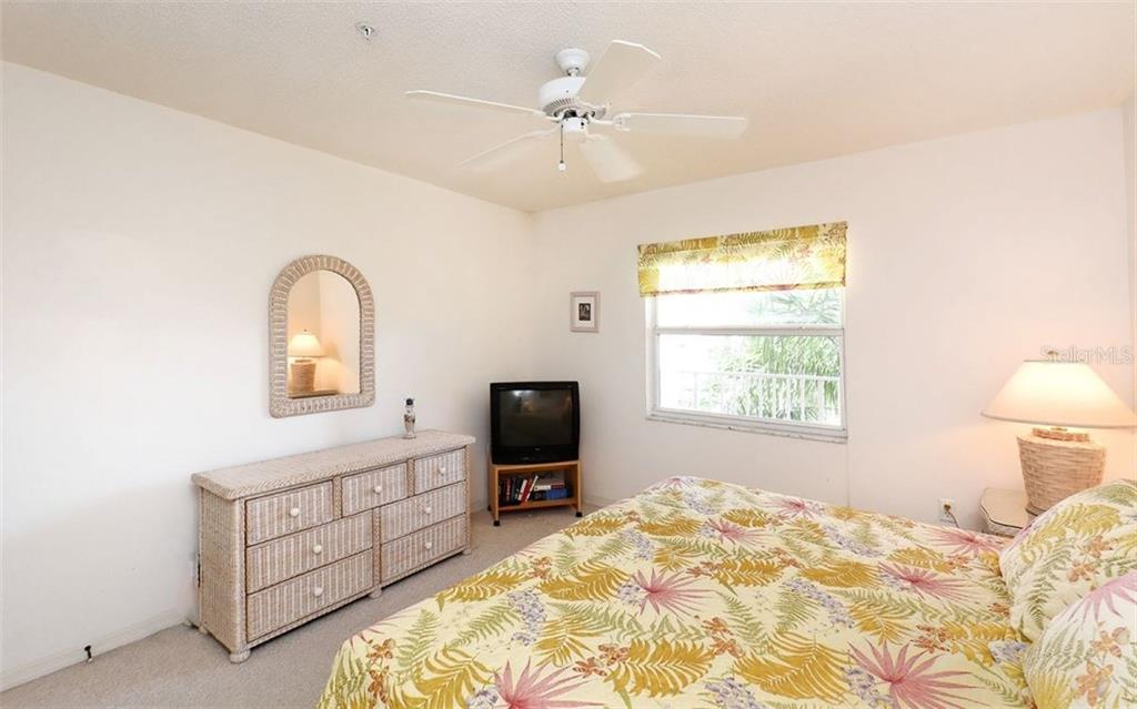 Guest bedroom - the unit is sold turn-key furnished. - Condo for sale at 8750 Olde Hickory Ave #9305, Sarasota, FL 34238 - MLS Number is A4178271