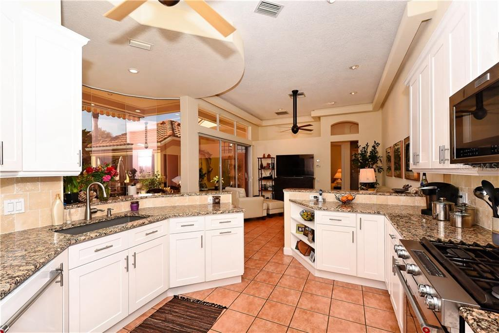 Kitchen with entry to Dining Room - Single Family Home for sale at 602 Weston Pointe Ct, Longboat Key, FL 34228 - MLS Number is A4178531