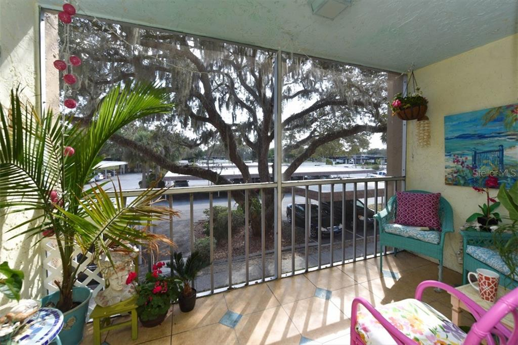 Charming lanai, newly tiled and serene mood. - Condo for sale at 1330 Glen Oaks Dr E #275d, Sarasota, FL 34232 - MLS Number is A4178649
