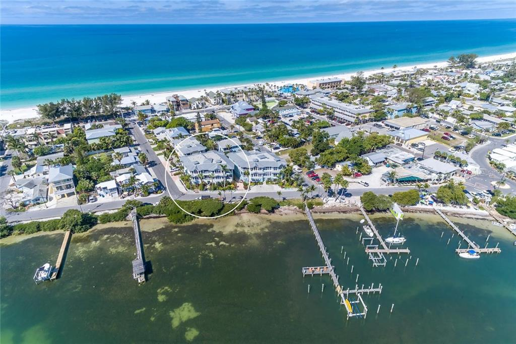 Your own assigned dock space on the Bay with no fixed bridges between you and the Gulf. Or travel north or south on the protected  Intercoastal Waterway! - Condo for sale at 318 Bay Dr S #7, Bradenton Beach, FL 34217 - MLS Number is A4178742