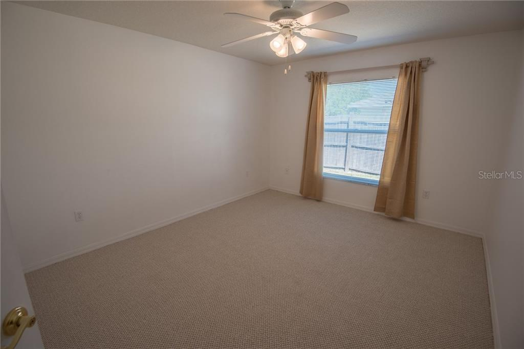 2nd bedroom with brand new carpeting - Single Family Home for sale at 7718 36th Ln E, Sarasota, FL 34243 - MLS Number is A4181555