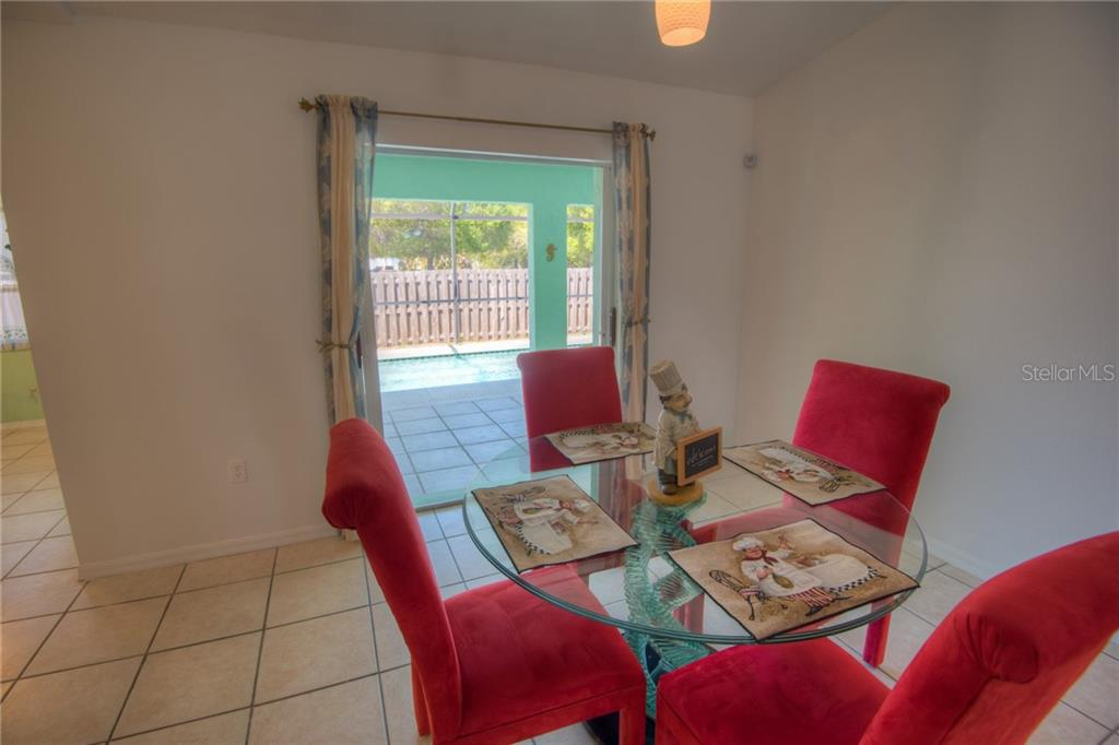 Dining area off pool area - Single Family Home for sale at 7718 36th Ln E, Sarasota, FL 34243 - MLS Number is A4181555