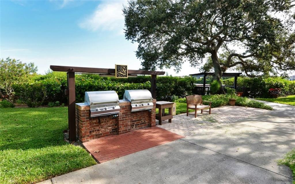 Community BBQ patio - Condo for sale at 6263 Midnight Pass Rd #101, Sarasota, FL 34242 - MLS Number is A4182245
