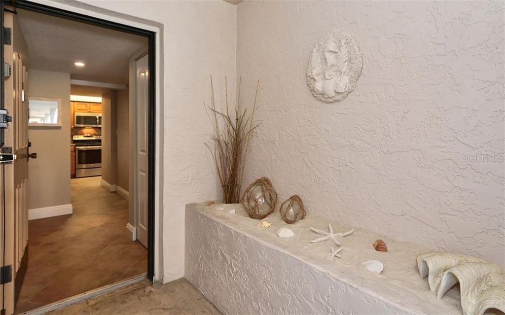 Entry - Condo for sale at 6263 Midnight Pass Rd #101, Sarasota, FL 34242 - MLS Number is A4182245