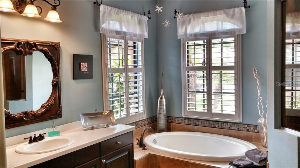 Master bathroom - Single Family Home for sale at 7658 Trillium Blvd, Sarasota, FL 34241 - MLS Number is A4182608