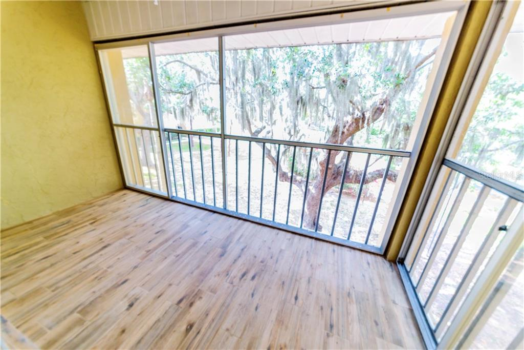 Wood Tile Looks Awesome! - Condo for sale at 1310 Glen Oaks Dr E #388e, Sarasota, FL 34232 - MLS Number is A4182635