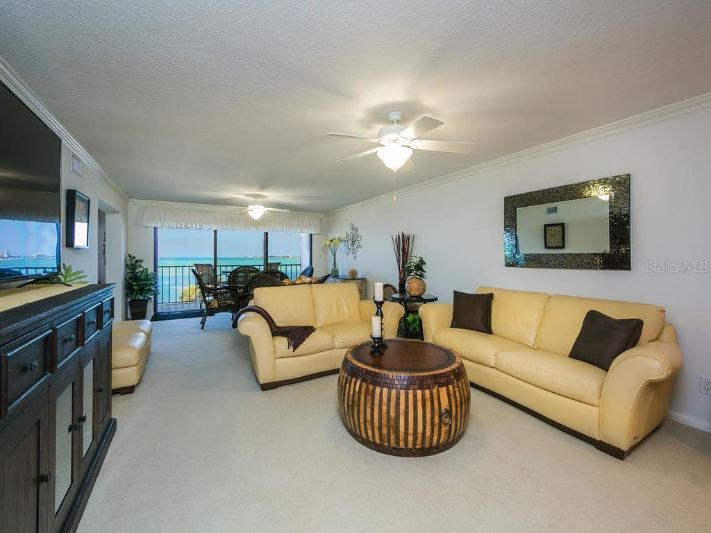 Living room with sliders to balcony - Condo for sale at 4708 Ocean Blvd #e8, Sarasota, FL 34242 - MLS Number is A4184028