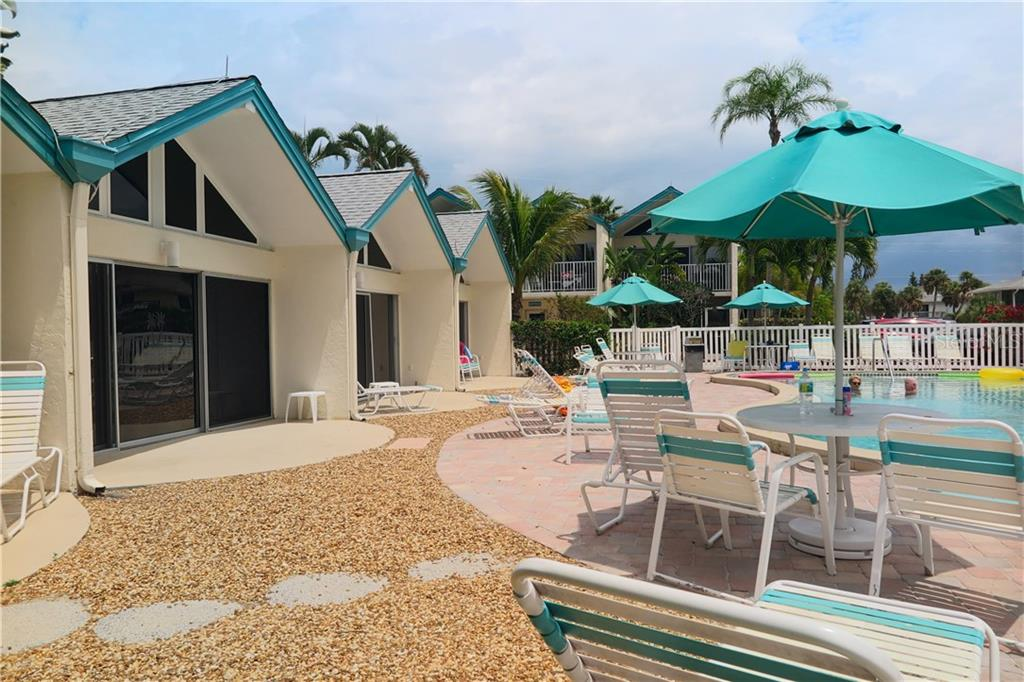 Pool area and poolside units - Condo for sale at 100 73rd St #202a, Holmes Beach, FL 34217 - MLS Number is A4184505