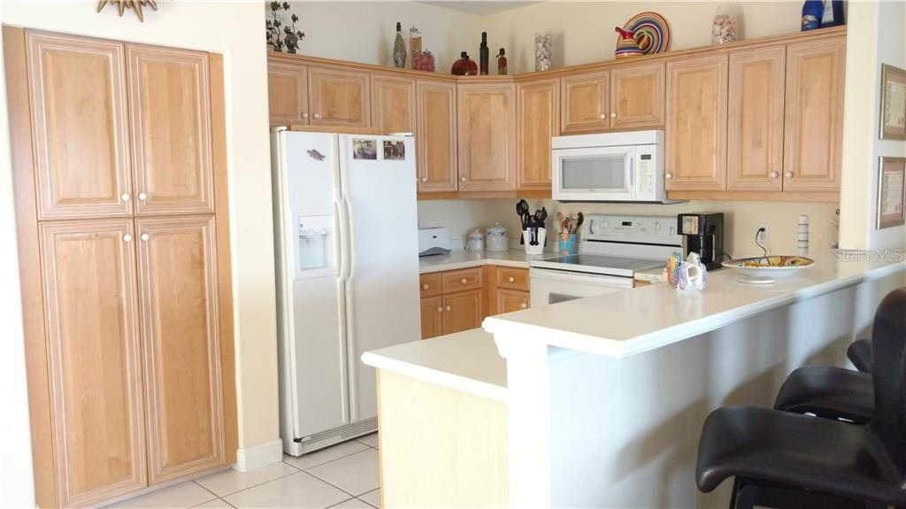 Lovely open kitchen - Condo for sale at 9209 Midnight Pass Rd #5, Sarasota, FL 34242 - MLS Number is A4185067