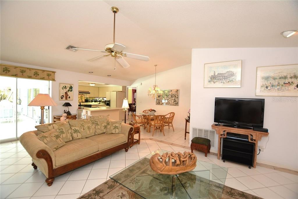 Simply open the sliders in the family room and extend your living space to the screened lanai. - Single Family Home for sale at 1157 Wyeth Dr, Nokomis, FL 34275 - MLS Number is A4185839