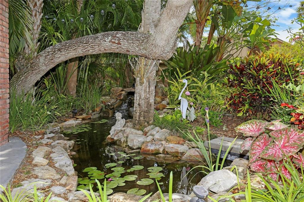 Enjoy the water feature pond next to outdoor pergola. - Single Family Home for sale at 3765 Beneva Oaks Blvd, Sarasota, FL 34238 - MLS Number is A4185879