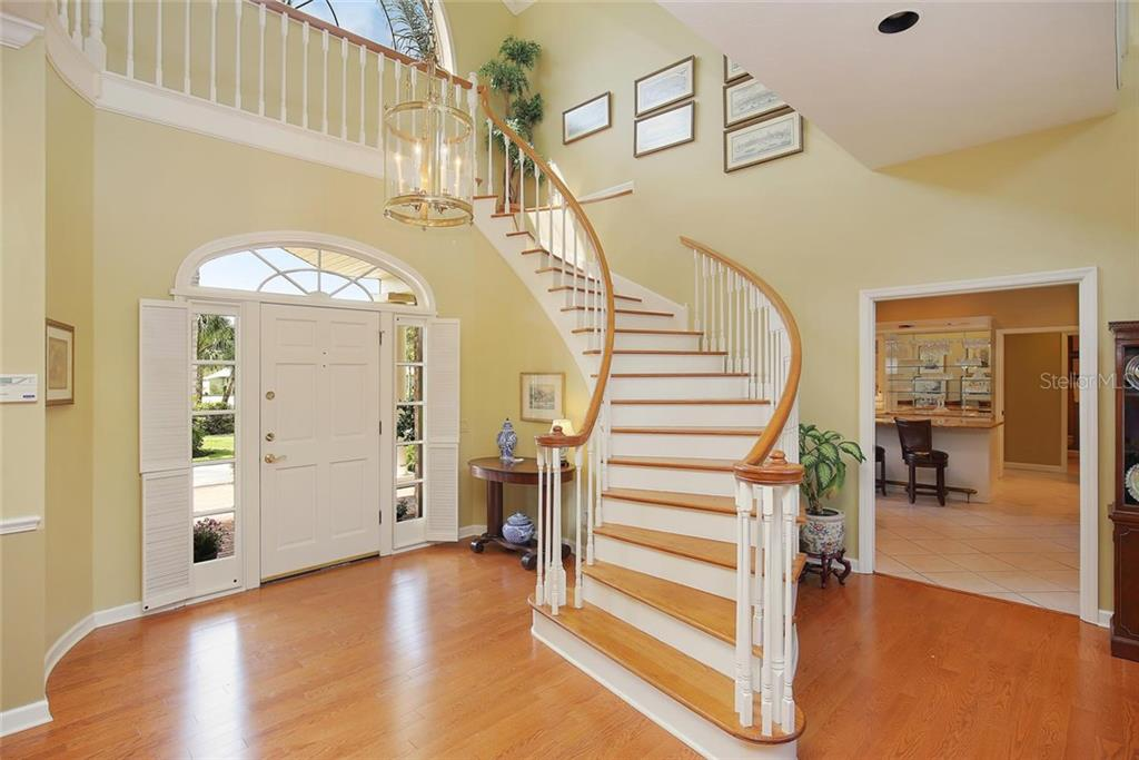 Beautiful staircase with double front doors and transom windows. - Single Family Home for sale at 3765 Beneva Oaks Blvd, Sarasota, FL 34238 - MLS Number is A4185879