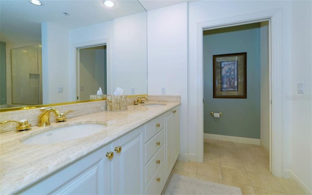 Master bathroom with double sink vanity - Condo for sale at 1310 Old Stickney Point Rd #e53, Sarasota, FL 34242 - MLS Number is A4186018