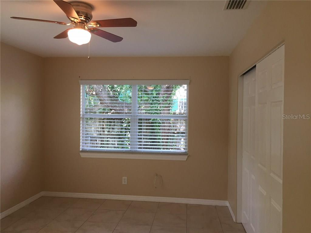All new window treatments. Bedroom 2. - Single Family Home for sale at 938 Highland St, Sarasota, FL 34234 - MLS Number is A4186423