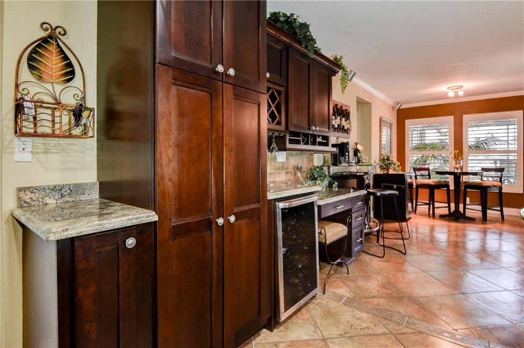 The  family room in this open floor plan is great entertaining space. Open the French doors to the outdoor living space. - Single Family Home for sale at 8916 44th Avenue Dr W, Bradenton, FL 34210 - MLS Number is A4186449