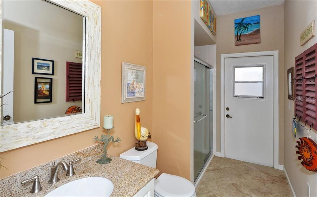 Pool bathroom with shower & 4th bedrooms bath area. - Single Family Home for sale at 4121 Via Mirada, Sarasota, FL 34238 - MLS Number is A4186485