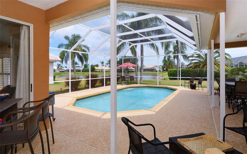 New Pebbletech surface, 6 foot end, lake view, new screening and new deck surface. Aluminum cage completely reconditioned. - Single Family Home for sale at 4121 Via Mirada, Sarasota, FL 34238 - MLS Number is A4186485
