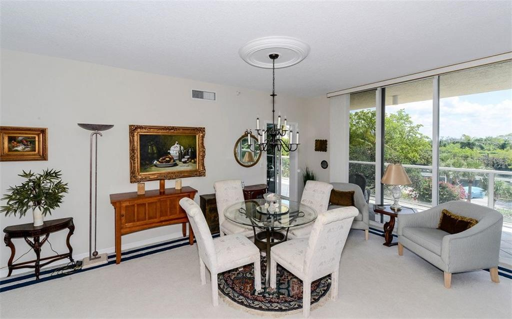 Dining room with a view - Condo for sale at 1800 Benjamin Franklin Dr #a202, Sarasota, FL 34236 - MLS Number is A4187131