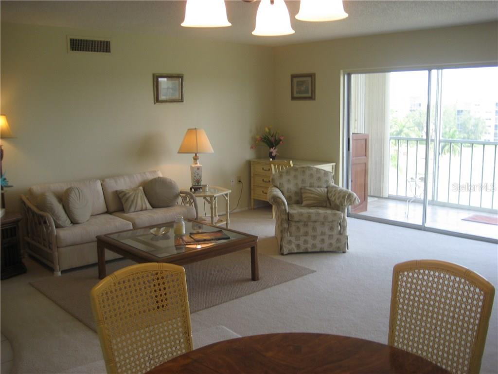 Living room/dining room combination with open feeling, lots of Florida sunshine brightens the room - Condo for sale at 3820 Ironwood Ln #606i, Bradenton, FL 34209 - MLS Number is A4187664