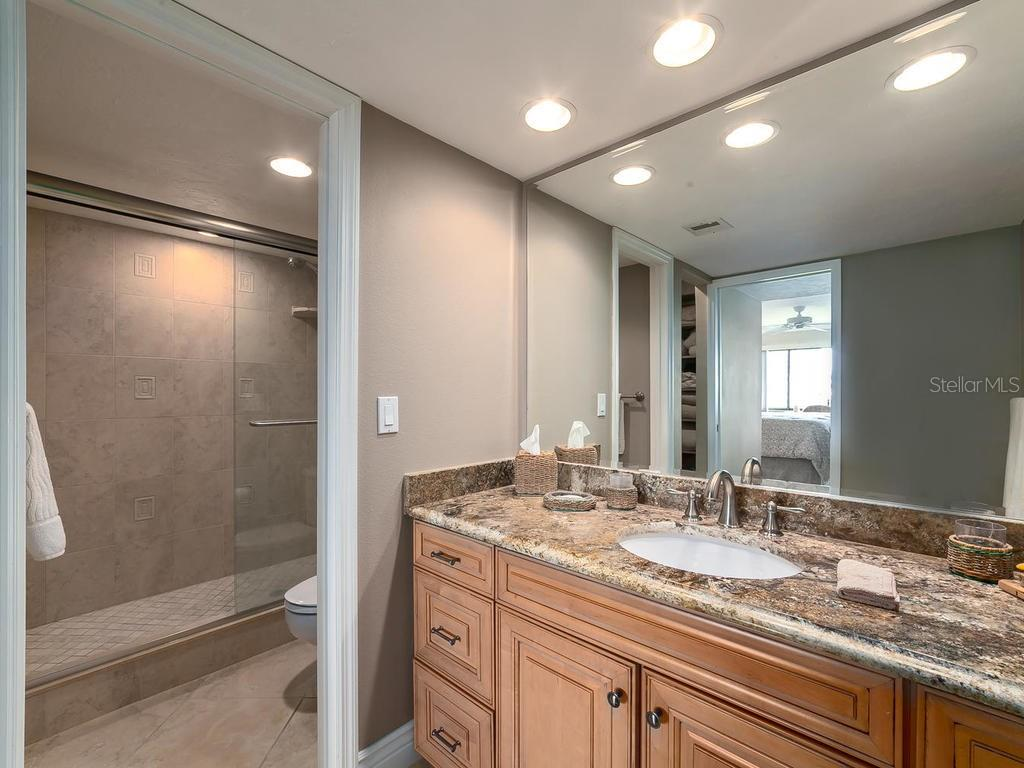 Master bathroom with walk-in shower - Condo for sale at 6236 Midnight Pass Rd #406, Sarasota, FL 34242 - MLS Number is A4188093