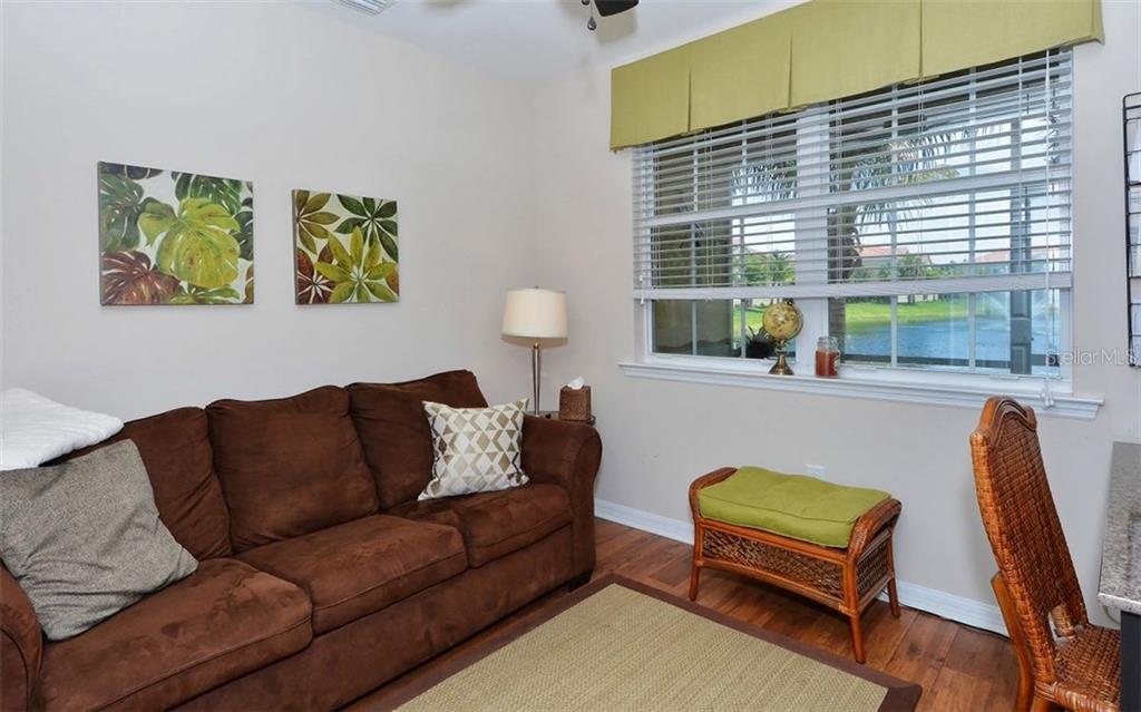 Den with lake views - Condo for sale at 81 Navigation Cir #103, Osprey, FL 34229 - MLS Number is A4188370