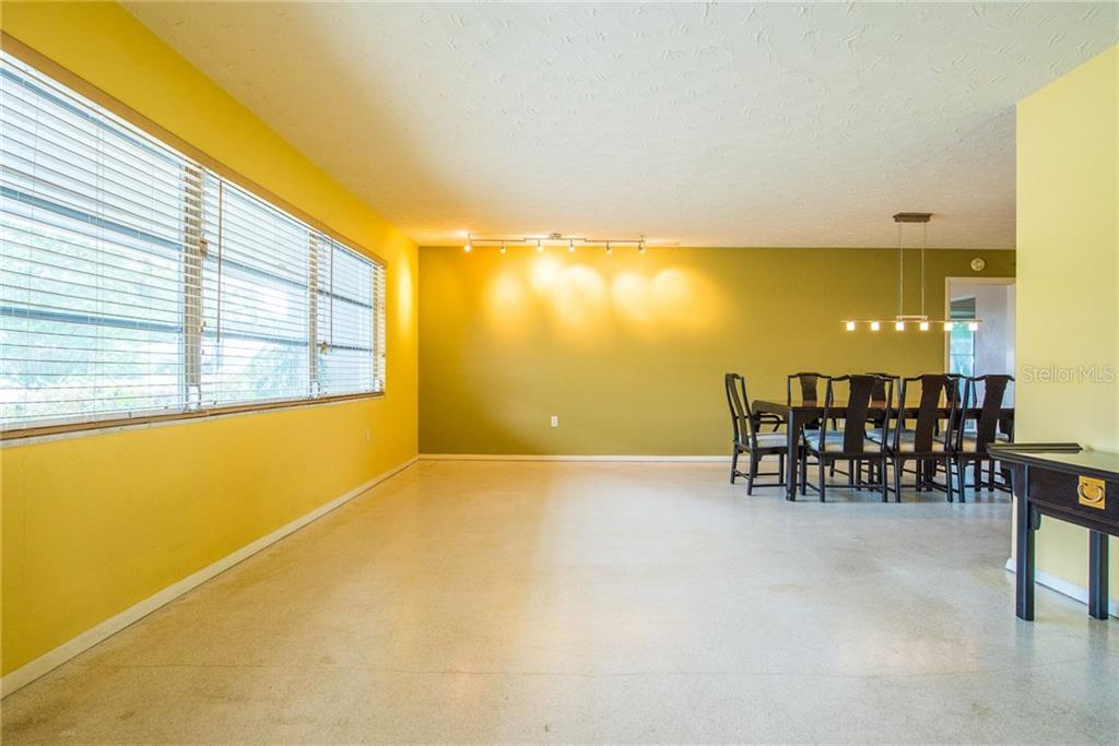 Living room/Dining room - Single Family Home for sale at 3448 Pine Valley Dr, Sarasota, FL 34239 - MLS Number is A4188545