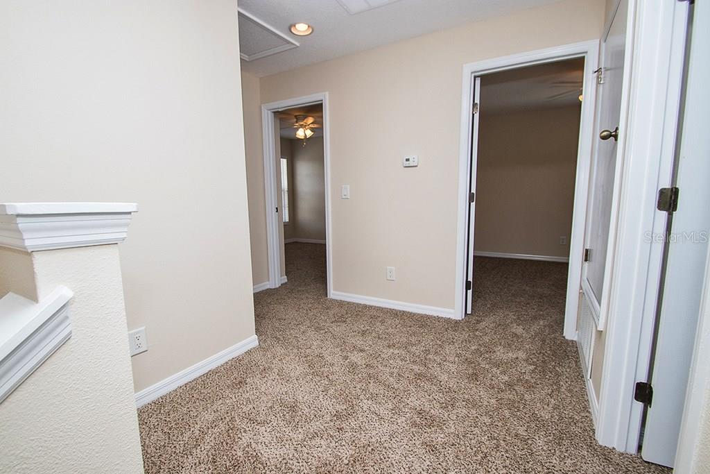 Upstairs hall new carpet - Single Family Home for sale at 10212 37th Ct E, Parrish, FL 34219 - MLS Number is A4188756