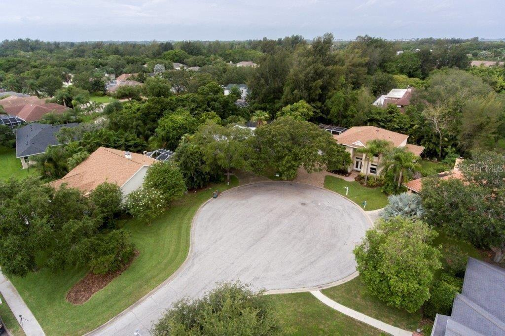 An overhead view showing the beautiful, large trees in the neighborhood and the privacy of the location. Robinson's preserve is in the background. - Single Family Home for sale at 9122 16th Avenue Cir Nw, Bradenton, FL 34209 - MLS Number is A4189396