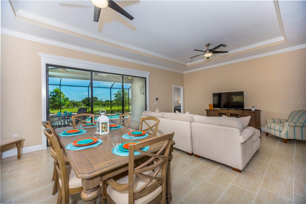 Great room to lanai and pool - Single Family Home for sale at 23883 Waverly Cir, Venice, FL 34293 - MLS Number is A4190222