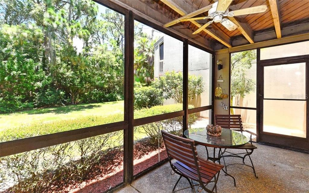 Large screened, shady lanai overlooking lush greenery - Condo for sale at 104 Woodland Pl #104, Osprey, FL 34229 - MLS Number is A4190676