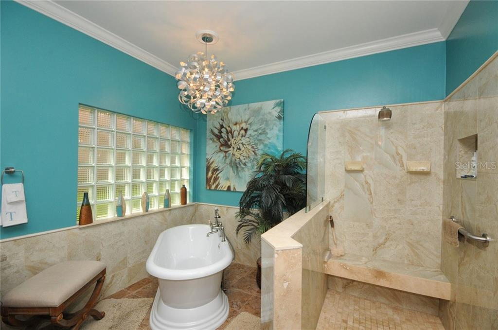 Master bathroom tub and shower - Villa for sale at 7707 Calle Facil, Sarasota, FL 34238 - MLS Number is A4191635