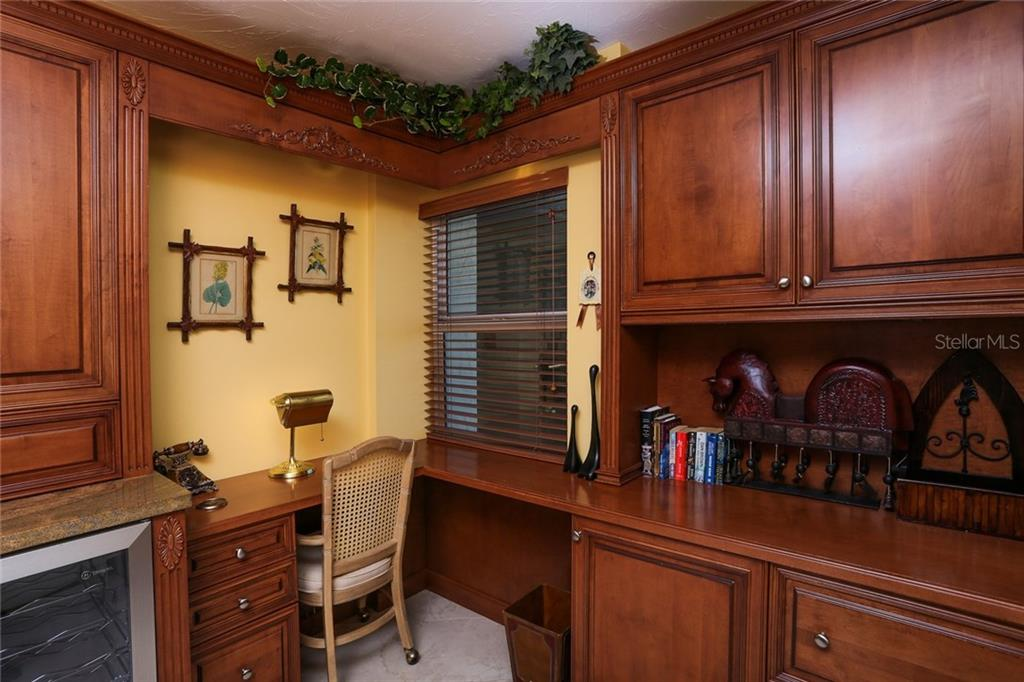 Built-in desk in kitchen - Condo for sale at 20 Whispering Sands Dr #1103, Sarasota, FL 34242 - MLS Number is A4192663