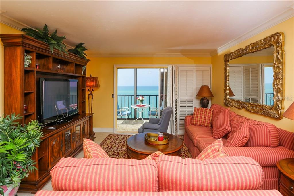 Living room with Gulf views - Condo for sale at 20 Whispering Sands Dr #1103, Sarasota, FL 34242 - MLS Number is A4192663