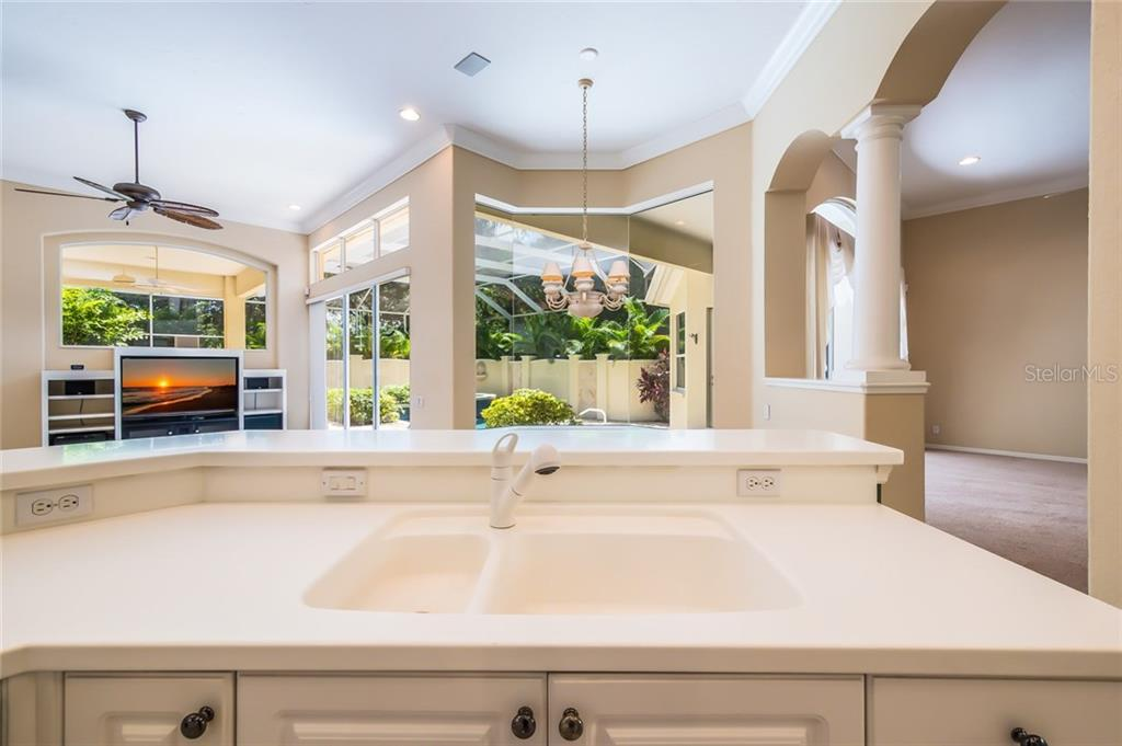 An open floor plan.  A birds' eye view from command central - the kitchen! - Single Family Home for sale at 8019 Collingwood Ct, University Park, FL 34201 - MLS Number is A4193802