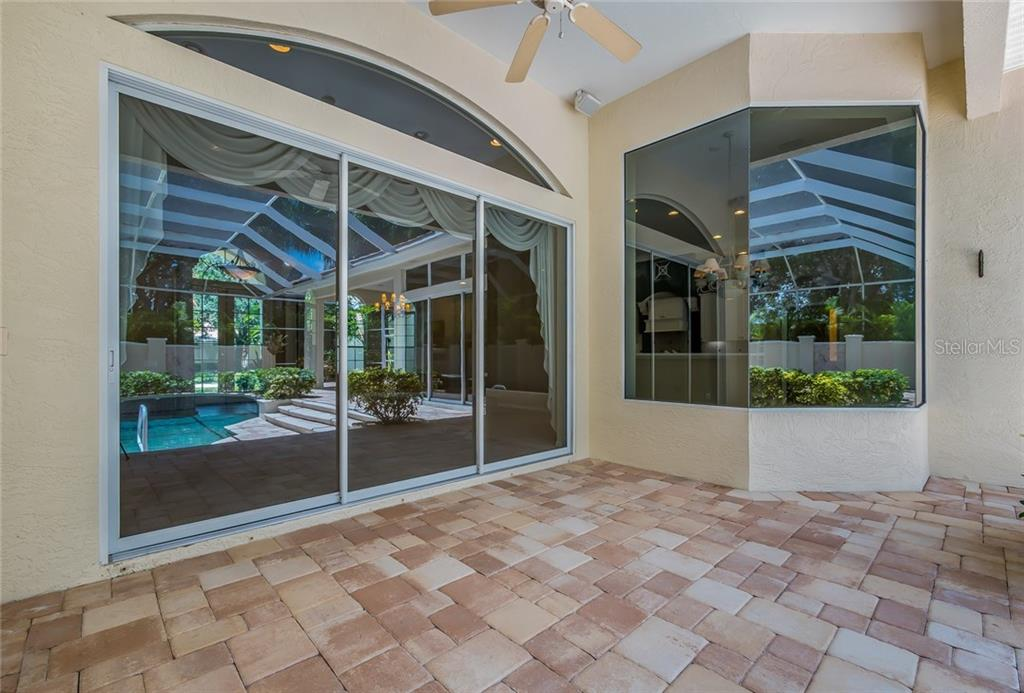 There are two covered outdoor areas, all pavers. - Single Family Home for sale at 8019 Collingwood Ct, University Park, FL 34201 - MLS Number is A4193802