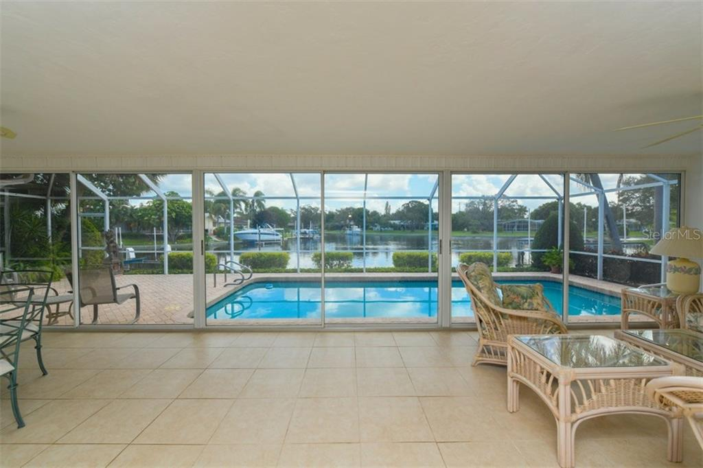 Covered lanai and swimming pool with Canal views - Single Family Home for sale at 5515 Contento Dr, Sarasota, FL 34242 - MLS Number is A4194719