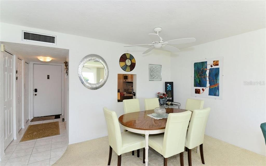 Dining Room Open to Kitchen - Condo for sale at 4700 Gulf Of Mexico Dr #203, Longboat Key, FL 34228 - MLS Number is A4195618