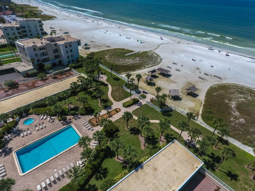 Aerial view of gulf side community showing swimming pool, spa, sun deck and private beach cabanas - Condo for sale at 6140 Midnight Pass Rd #c-9, Sarasota, FL 34242 - MLS Number is A4195879