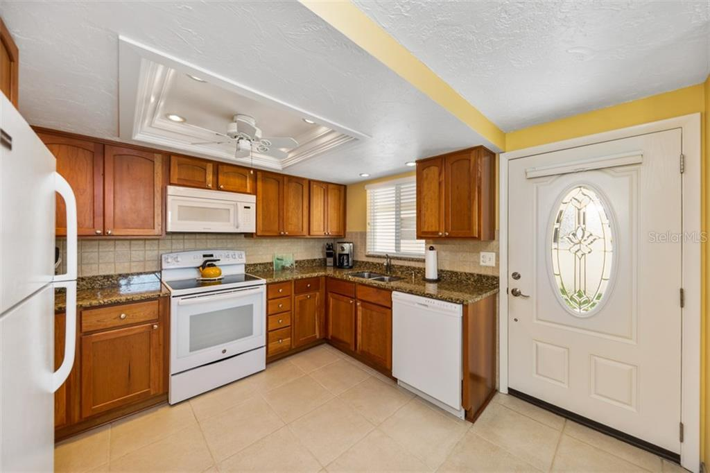 Kitchen and entry - Condo for sale at 6140 Midnight Pass Rd #c-9, Sarasota, FL 34242 - MLS Number is A4195879