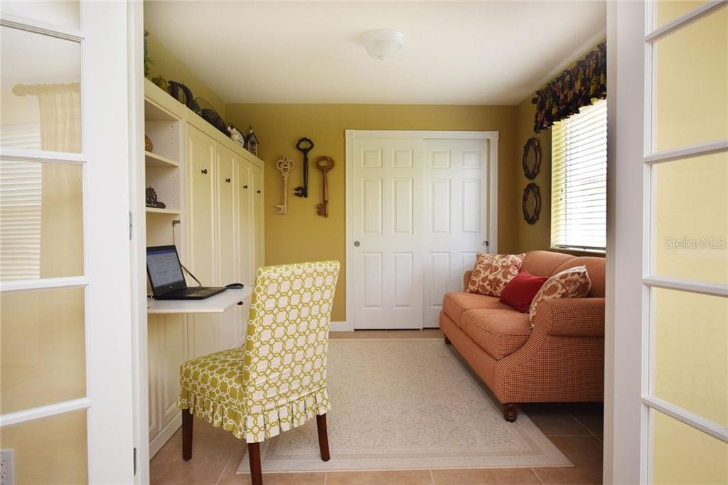 Murphy bed with built-in desk in the Den - Villa for sale at 2127 Burgos Dr, Sarasota, FL 34238 - MLS Number is A4195921