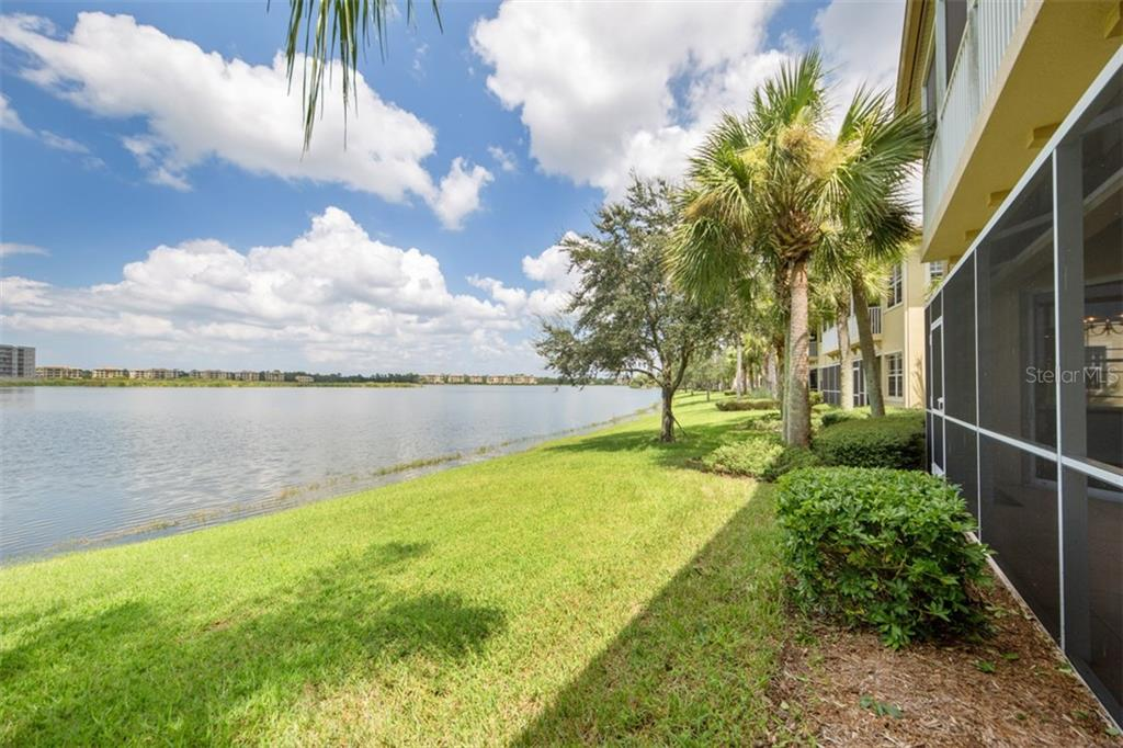 Gorgeous view over 160 acre Lake Uihlein from back of unit. - Condo for sale at 6415 Moorings Point Cir #102, Lakewood Ranch, FL 34202 - MLS Number is A4196054
