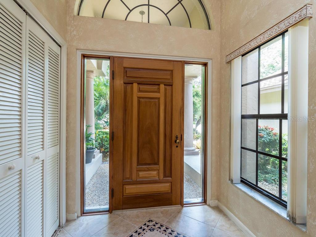 Front door inside Foyer - Single Family Home for sale at 7520 Weeping Willow Dr, Sarasota, FL 34241 - MLS Number is A4196497