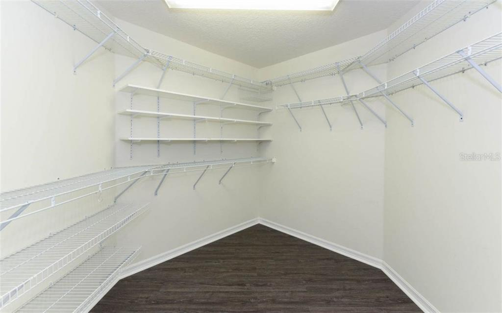 spacious walk-in closet - Single Family Home for sale at 8712 54th Ave E, Bradenton, FL 34211 - MLS Number is A4196623