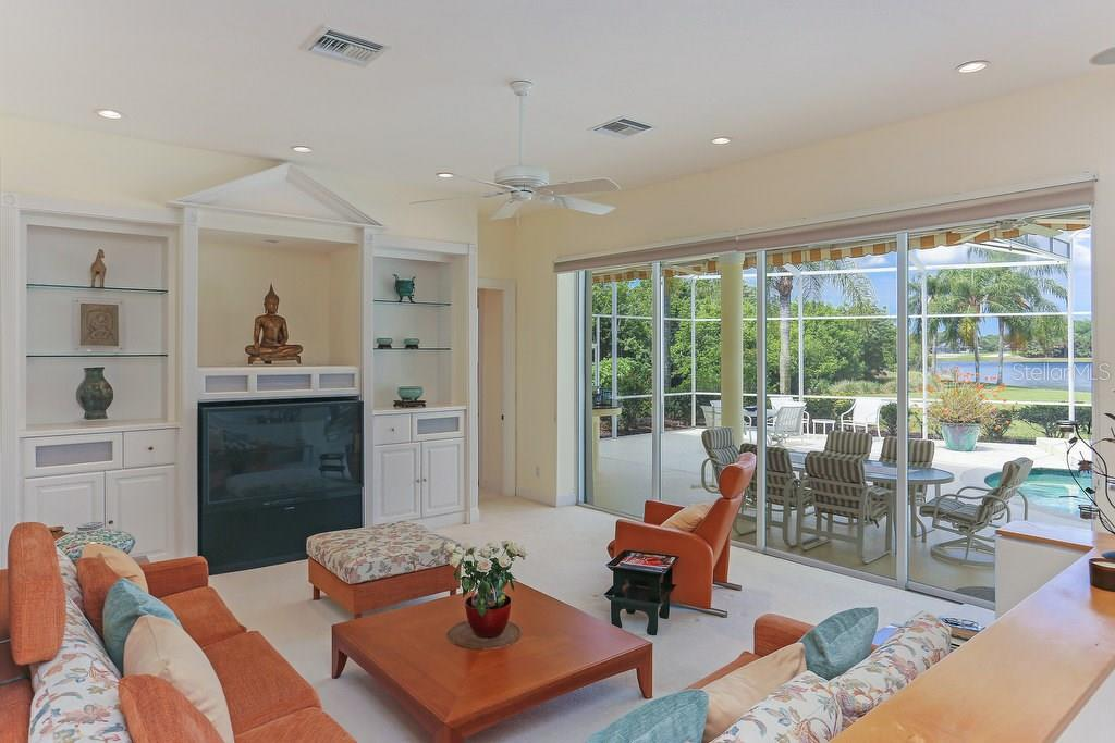 Great room off of the kitchen with views of lake & pool - Single Family Home for sale at 7332 Chelsea Ct, University Park, FL 34201 - MLS Number is A4196805
