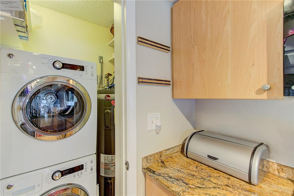 Stacked Washer and Dryer for ease and convenience - Condo for sale at 600 Manatee Ave #236, Holmes Beach, FL 34217 - MLS Number is A4197636
