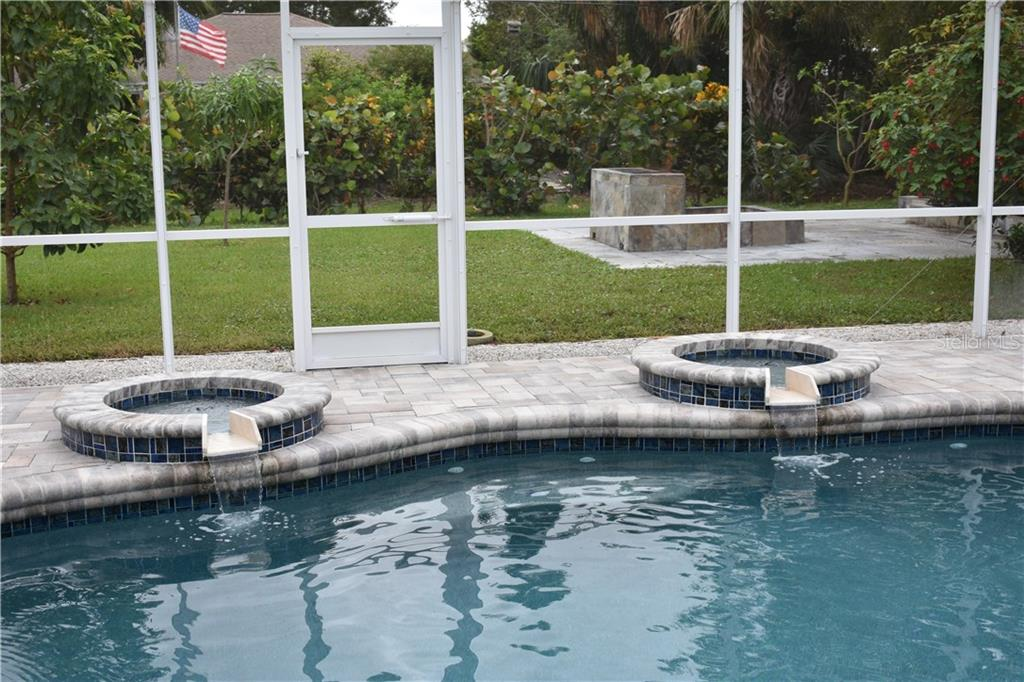 Enjoy the serene churning of waterfall fountains. - Single Family Home for sale at 1133 Riviera St, Venice, FL 34285 - MLS Number is A4197682
