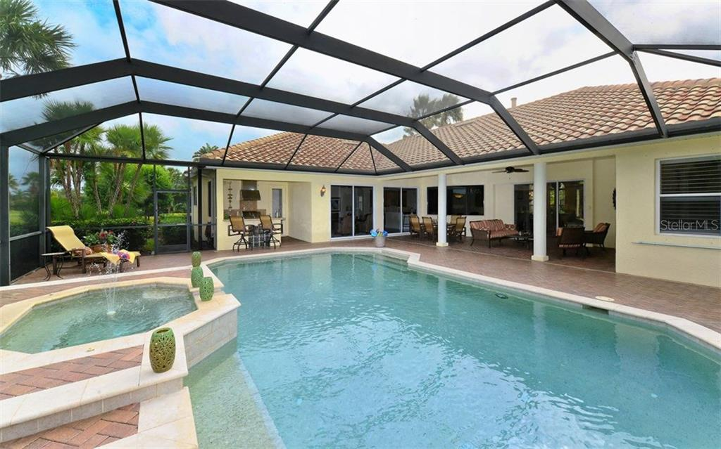 Pool from rear corner - Single Family Home for sale at 9919 Portside Ter, Bradenton, FL 34212 - MLS Number is A4197815